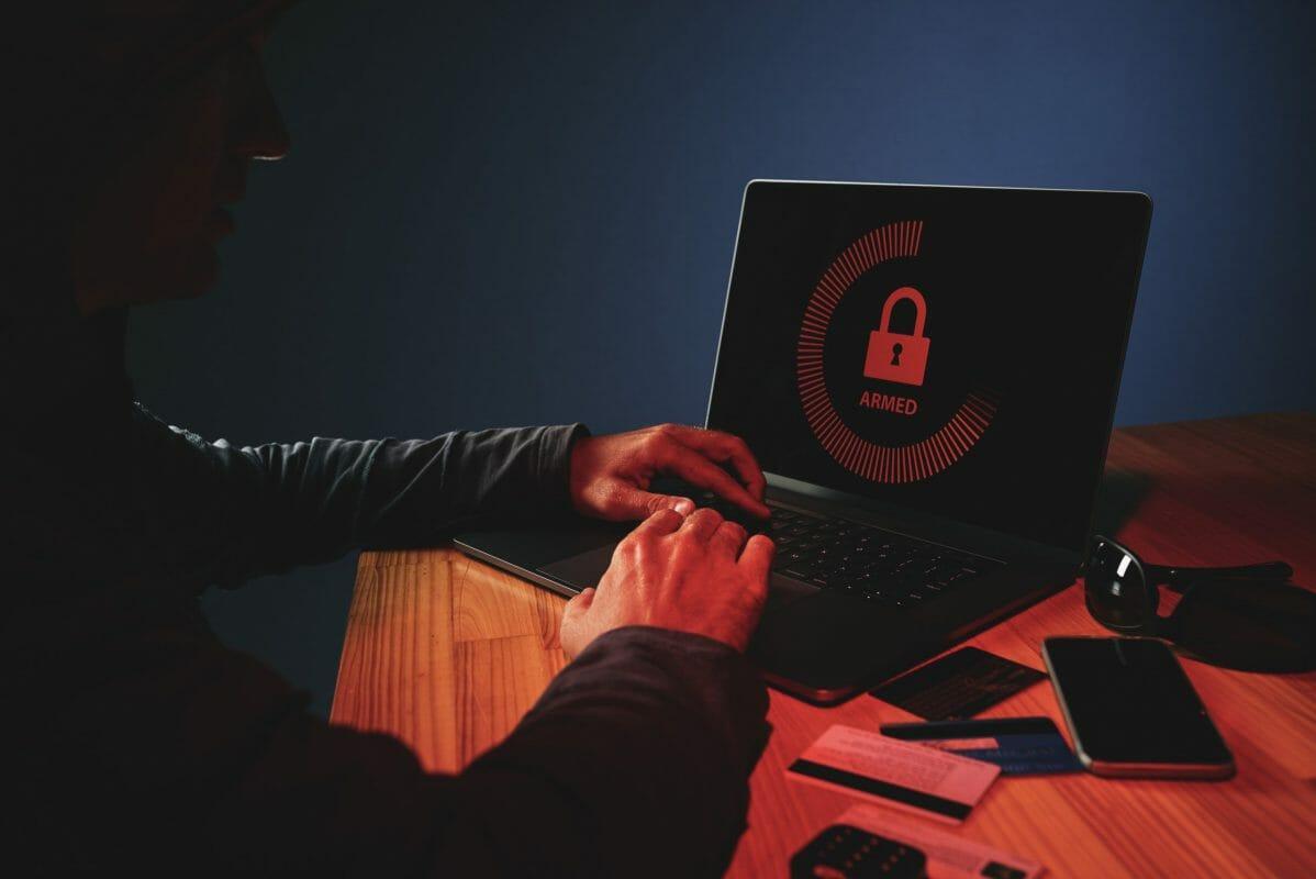 Criminal-hacking-password-on-laptop-520601-scaled