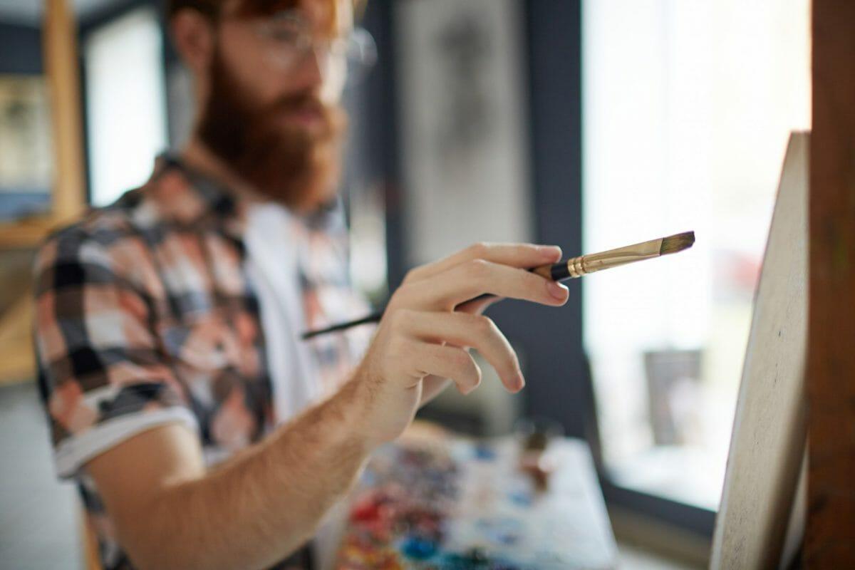 Man-with-paintbrush-383785-scaled