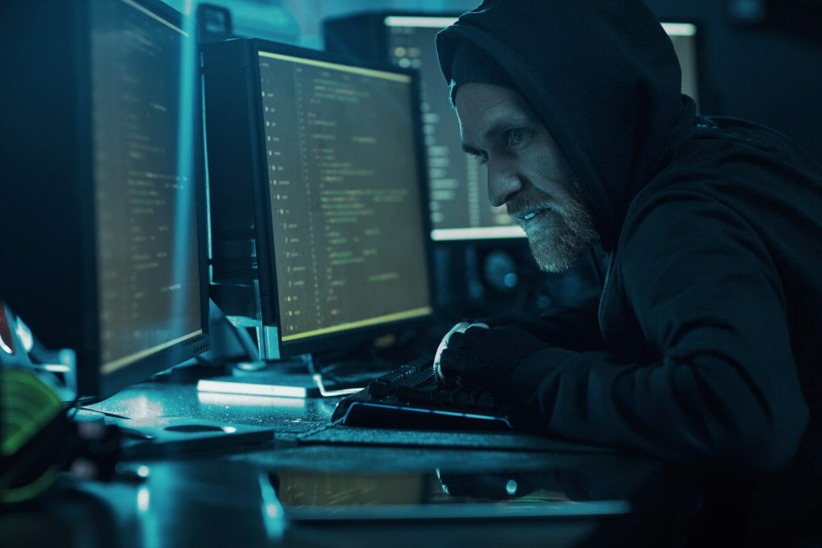 Hacker-typing-on-keyboard-796283-scaled