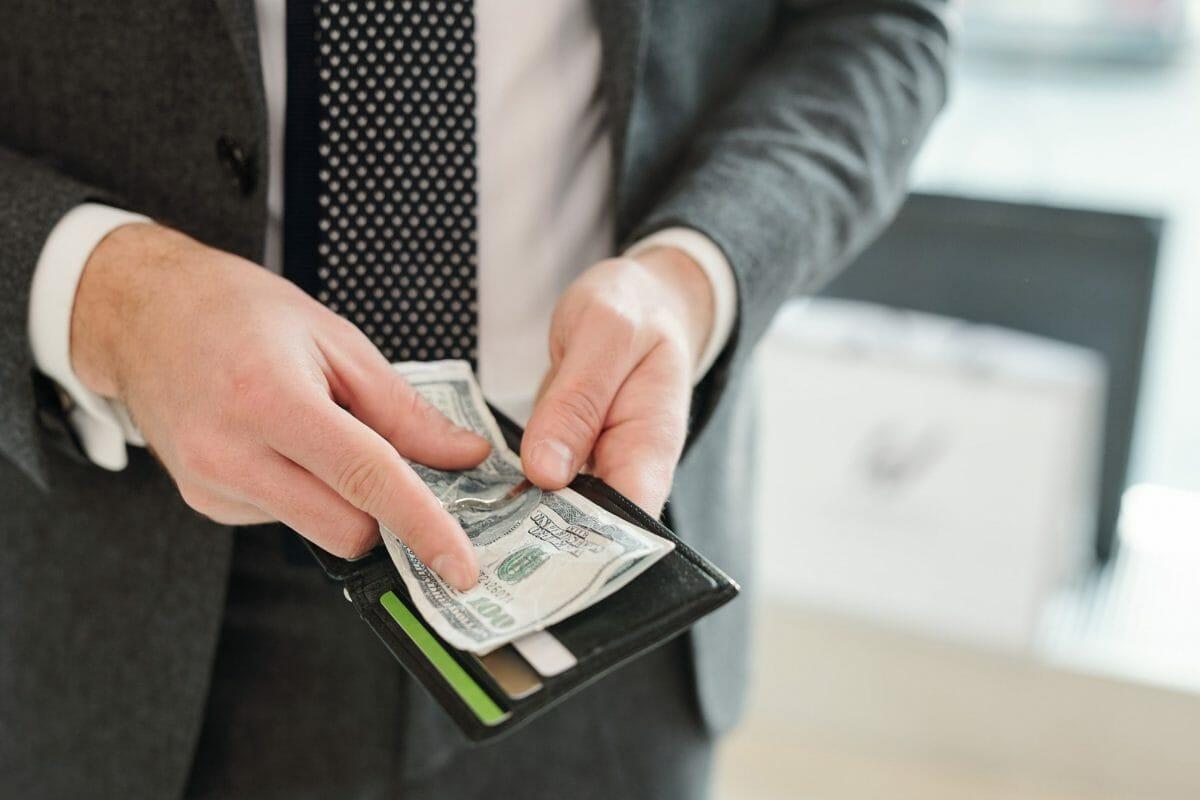 Hands-of-rich-elegant-businessman-444130-scaled