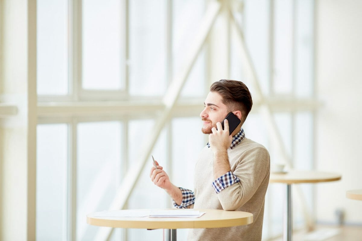 Creative-man-speaking-on-phone-388538-scaled