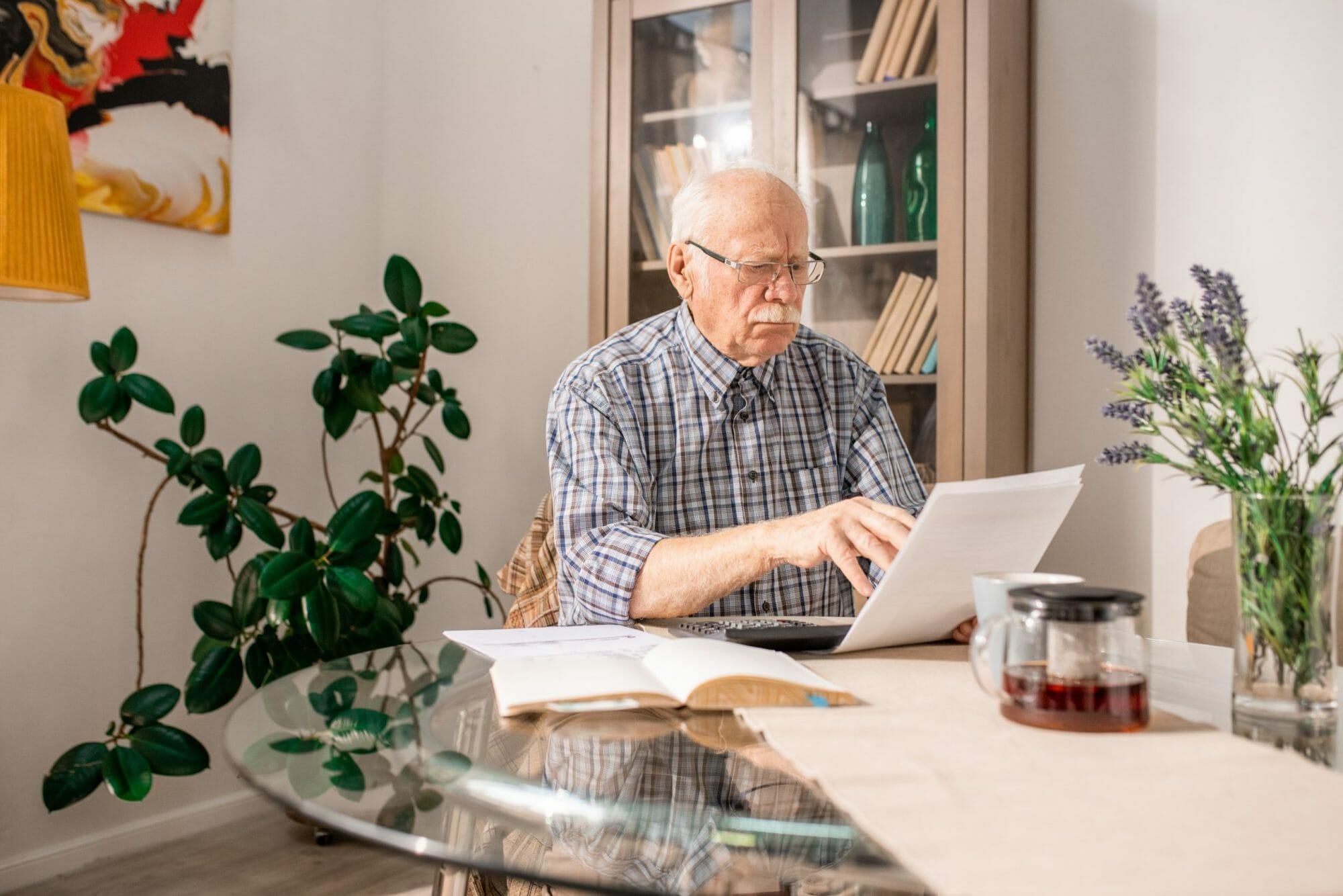 Senior-man-filling-tax-form-552599-scaled