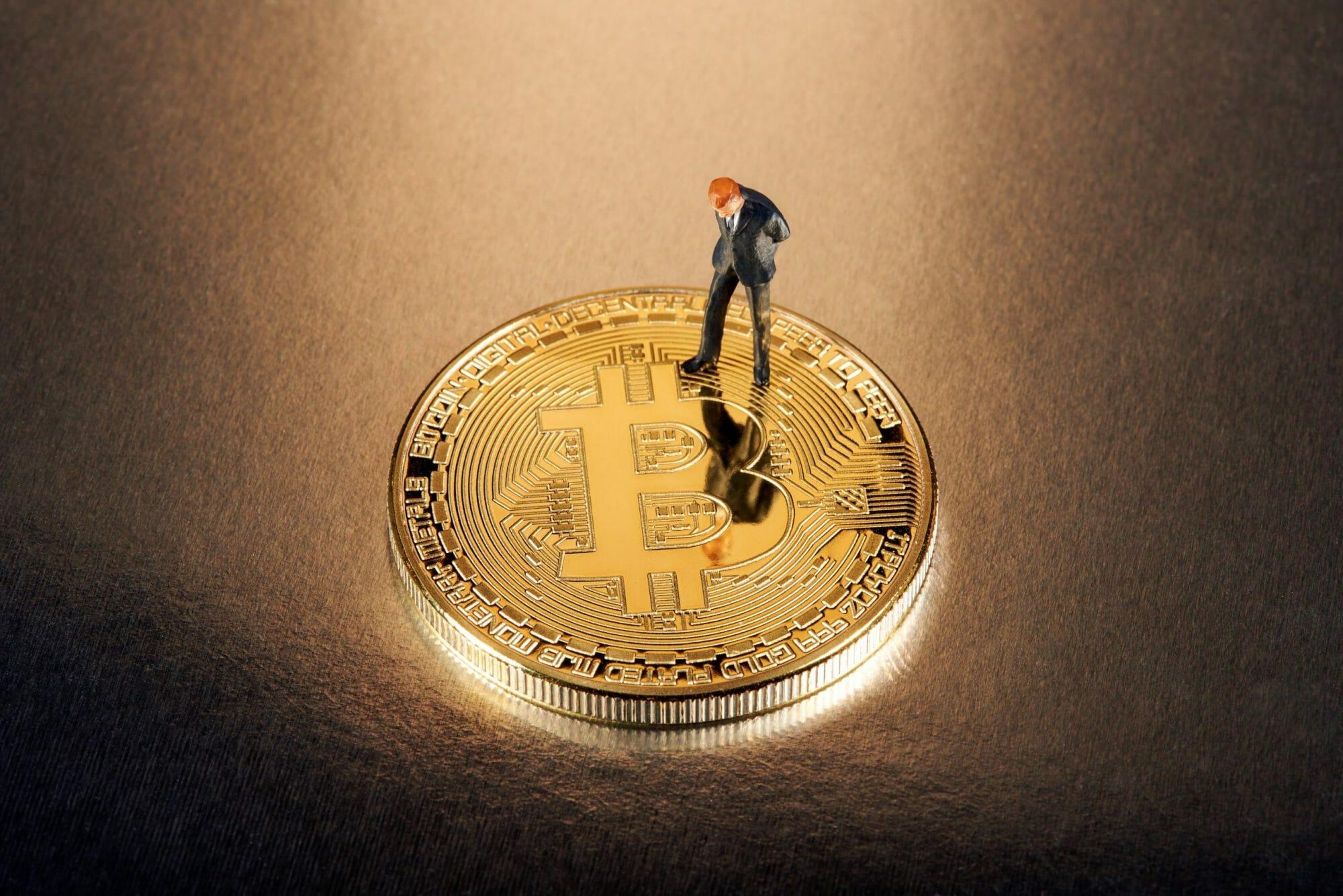 Miniature-figure-on-bitcoin-724712-scaled