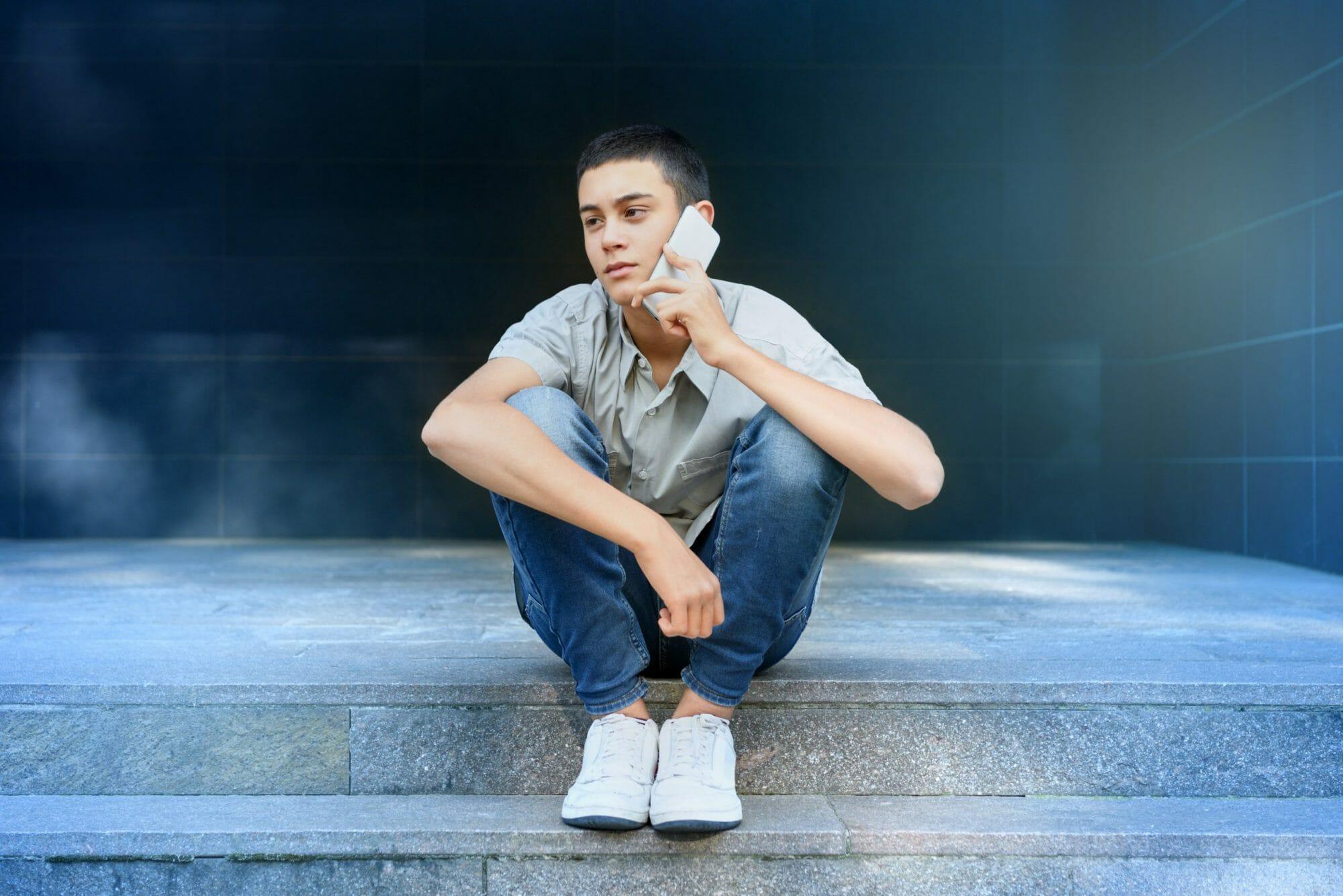 Teenage-boy-chatting-733520-scaled