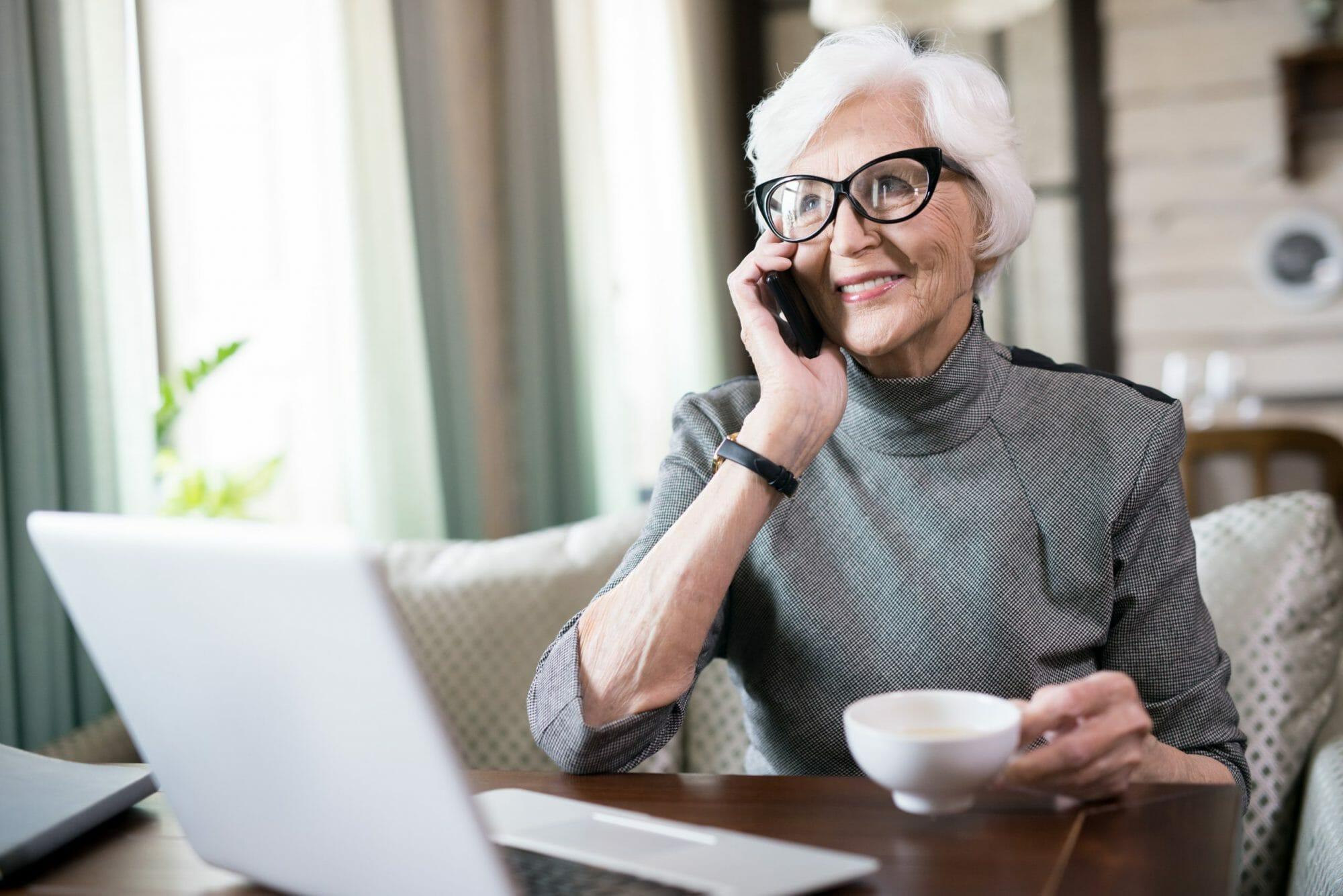 Senior-woman-talking-on-phone-566931-scaled